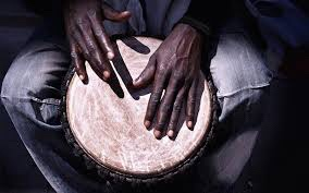 Beating African drums